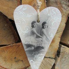 Wooden heart with ballerinas