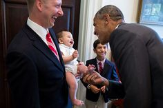 President Barack Obama greets the family of departing staff member Archana Snyder, Council of Economic Advisers, in the Outer Oval Office, July 3, 2014.