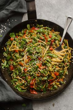 This spicy green bean stir-fry is one of my favorite ways to use fresh summer green beans and the star of this quick, vegetarian dinner.