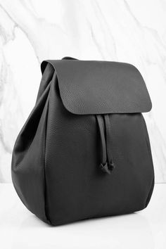 Cute and trendy black faux leather backpack. Perfect for a day out.