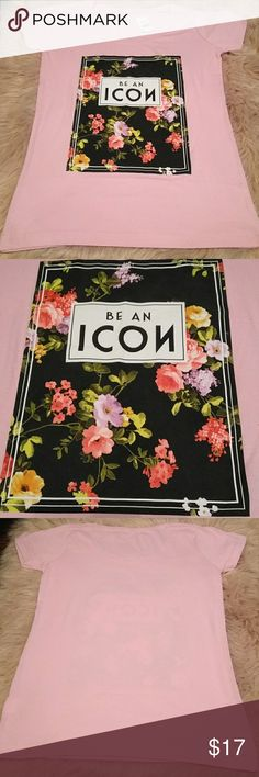 "🆕🏷️""Be an Icon""Pink floral graphic tee shirt Brand new with tags be an icon pink floral graphic t-shirt. Size XL but can definitely fit a size L as well.   ***Create a bundle & Save some money!! Not only on shipping but I love to work with anyone so that the end result leaves us both happy that we have worked together♥️♥️♥️*** Tops Tees - Short Sleeve"