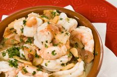 Scampi Style Prawns Heat the oil and garlic in a large frying pan over medium heat until garlic sizzles. Turn the heat to medium low and cook the garlic till golden. Add prawns until they sizzles and then add wine and continue cooking until prawns are pink. Swirl in butter and parsley.