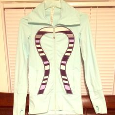 "BRANDNEW Lululemon AUTH. BRAND NEW Sz2 hoodie mint Brand new never worn authentic ""RARE"" Lululemon size 2 stretch super soft perfect for the spring/summer.Perfect condition mint green ,Plus anything lululemon is quality and the best in my opinion.plus lulu makes everyones body look hot&athletic. I'm 5 feet tall and it's a little long on me perfect for 5'2"" and above. Make an offer. Cleaning everything in my closet out. lululemon athletica Tops"