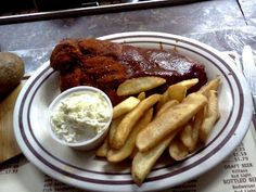 """A half slab of ribs from the defunct Jack's Bar-B-Q Rib Shack in Memphis, TN. Half of it is """"wet"""" and the other is some of the best tasting dry rub that I've ever had. Sorry to see the place go."""