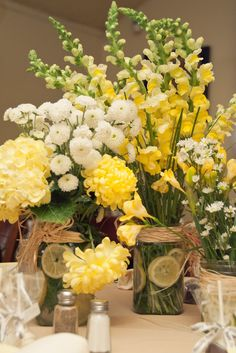 I want the limes in the mason jars and brown burlap on them. Table flowered.