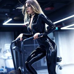 Fitness in black latex catsuit