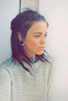 This is actually one of my favorite models, she used to have a marvelous head of bright red hair shaved on the sides like a mohawk, now she has a beautiful head of dreads :)