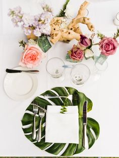 Tropical table setting: Catering: Chef Michael - http://www.stylemepretty.com/portfolio/chef-michael Floral Design: Studio South - http://www.stylemepretty.com/portfolio/studio-south Photography: Care Studios - www.careweddings.com   Read More on SMP: http://www.stylemepretty.com/2017/06/16/florida-beach-wedding/
