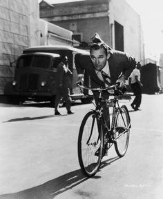 Bing Crosby bicycling in style