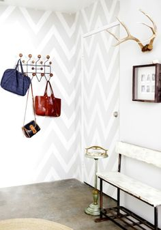 Love how the door is almost invisible as it is painted chevron with the adjacent wall...