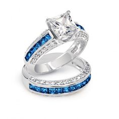 Incorporate a little royal blue into your engagement ring with this sapphire accented princess cut wedding ring set
