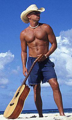 Kenny Chesney---I'd go sit on any island anywhere he'd go. I'd sit and look at him and listen to him sing.