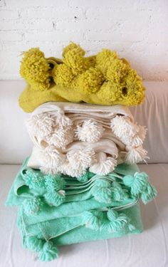 fine wool blankets with colorful pompoms, handwoven in Morocco
