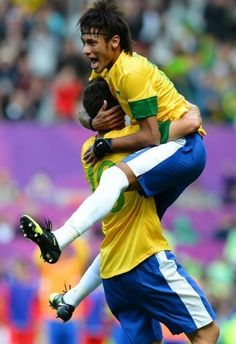 Brazil's Neymar (R) celebrates with teammate Oscar after scoring his team's second goal during the London 2012 Olympic Games men's football match between Brazil and Belarus at Old Trafford in Manchester. Neymar showed just why the world's top football clubs want to sign him with a virtuoso display as Brazil came from a goal behind to beat Belarus 3-1 at a packed Old Trafford on Sunday.