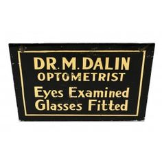 """rare turn of the century single-sided antique american hanging storefront reverse-painted """"eyes examined"""" black and gold leaf enameled glass optician trade sign"""