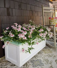 Large DIY Planter on Wheels {tutorial}: have a cute planter that you can move around on your deck. Good Idea.
