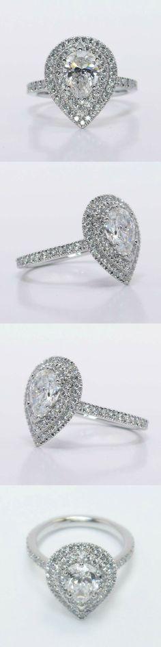 Custom Double Halo Diamond Engagement Ring! Pear 1.02 Ctw. Color: E Clarity: SI1 Polish: Very Good Diamond/Gem Cost: $3,833 Metal: Platinum Side Shape: Round Side Carat: 0.68 Side Color: F Side Clarity: VS2 Setting Cost: $2,995