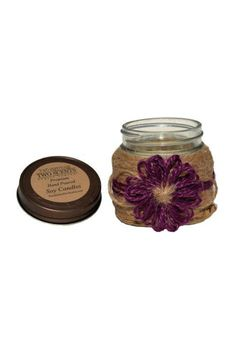 This fragrance is the sweet aroma of wild grapes enhanced with hints of strawberries and sweet sugary notes with a light alcoholic background. A wonderful aroma of red sweet cabernet wine. Our candles are handmade hand decorated and wrapped in 100% natural jute.  Measures: 14 oz  Candle Wine Cellar Medium by Two Sisters Two Scents. Home & Gifts - Home Decor - Candles & Scents Ohio