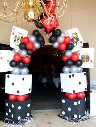 Cardboard boxes, balloons, paint, and something to make the arch (chicken wire maybe?)... This is very doable.