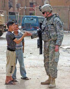 Us MP and Iraqi boy at war–thumb war. Nothing but friendly fire. Fatalities zero!.