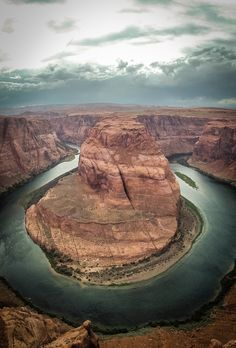 The incredible Horseshoe Bend near Page, Arizona. Just one of the places you must visit on a road trip of the American West