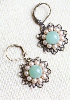 my one great love indie earrings  $28.99  These little earrings are so simple and beautiful with The little blue stone in the center surrounded by faux pearls and brass filigree. Indie made by MCM Designs.