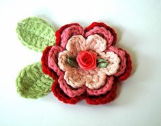 crochet flower - don't like the little flower in the middle but a button would be adorable
