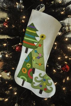 wool felt Christmas stocking with hand appliqued embroidery. Voor vilt: www. Christmas Stocking Decorations, Felt Christmas Stockings, Felt Stocking, Stocking Ideas, Stocking Decorating Ideas, Tree Decorations, Stocking Tree, Christmas Makes, Noel Christmas