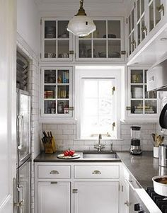 my kind of butler's pantry...subway tile, glass-front cabinets, soapstone countertops, vintage light pendant