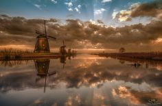 5 In a Row - Last week I visited Kinderdijk twice in the early morning. The first time it had been very cold and the canal was frozen. The second time the fog was so thick I could barely see the windmills the first hour. But after most of the fog had disappeared I was able to take this shot just before the sun would completely break through the clouds giving me too much hard light..................