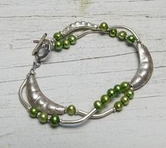 Peas in a pod.  Fine silver pea pods with pea green pearls handmade bracelet by ladeDAH!