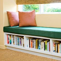 A shelf seat with dividers that offer support and carve out spaces for  books or baskets that organize mudroom miscellanea.   Photo: Mark Lohman   thisoldhouse.com