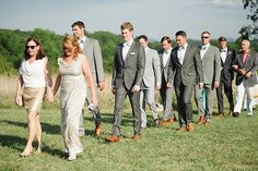 MOB and aunt-OB lead processional, followed by groomsmen, and then groom with mother and father   photos by April Bennett Photography @April Bennett Photography