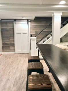 A HGTV fixer Upper basement remodel with shiplap wood walls, sliding barn doors, and industrial chic accents. Basement Storage, Basement Makeover, Basement Remodeling, Modern Basement, Cement Walls, Living Room Modern, Living Room Designs, Cellar, Cheap Basement Ideas
