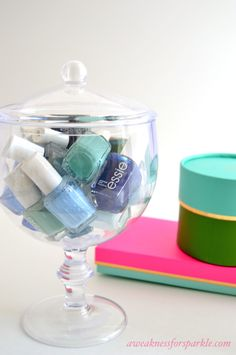 Apothecary jars as nail polish storage! Would look pretty on a bookshelf or bathroom counter