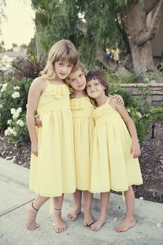 Pretty pastel yellow flower girl dresses {Photo by KLK Photography}