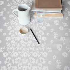 With the daisy as a motif, she has created a timeless design woven in the well-known damask quality. The design resembles a field of flowers with the little elegant daisies reminding us of a sunny day.  www.georgjensen-damask.com/daisy-tablecloths/