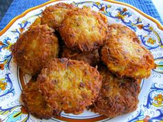 Cant wait for Chanukah to make these Latkes! 3 lbs. russet potatoes, peeled and rinsed 1 large white or brown onion, minced 2 tbsp schmaltz (rendered chicken fat - use peanut or grapeseed oil to make pareve) 3 tbsp chives, minced 3 tbsp matzo meal or panko 1 egg 1 egg yolk Salt and pepper Peanut or grapeseed oil for frying (about 1 1/2 cups)