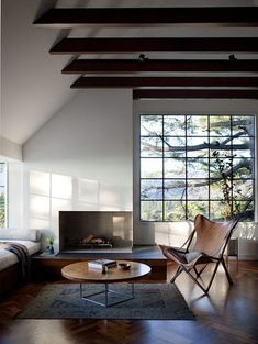 Exposed beams and vaulted ceiling. Asymmetry in the room...the reasons I love this space are many.