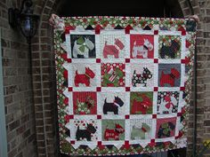 Goin' to the dogs quilt: finished! by Pink for me, via Flickr
