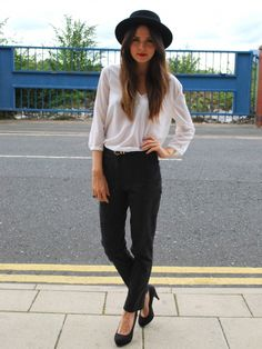 high waisted black jeans, thin white blouse, wide brimmed black hat, ombre hair, red lipstick, heels.