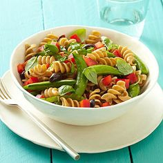 A simple red wine vinegar dressing makes this pasta salad side dish lower in fat and calories than most deli pasta salads.