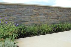 Multi Slate Cladding is ideal for a feature wall, keeping a natural colour scheme and feel throughout your entire garden design.