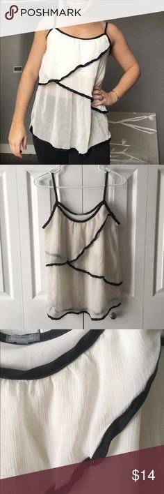 Cream Flutter Top Cream top with black accents. Pretty layers. In good, used condition. Charlotte Russe Tops Blouses