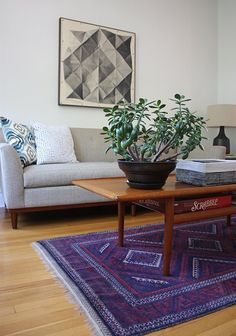 Love rug and coffee table with plant