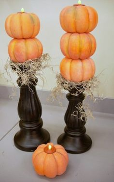 Here is an idea I got from the crazy talented Pattie Wilkinson. She used the real mini pumpkins and I used foam ones. She used an urn and plaque for a base and I used fat candle sticks. She used real tea lights and I used the battery operated ones… Hey, a girl has …