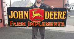 John Deere farm implements sign