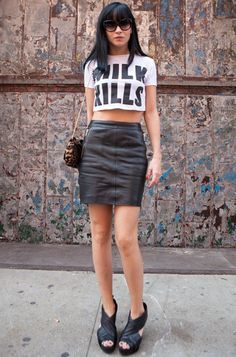 Leigh Lezark looking amazing in her leather skirt and slogan cropped top x