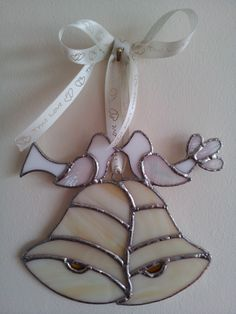 Stained glass suncatcher. My favourite, and I think unique... Wedding bells and Love Birds designed by Glass Gifts Garioch