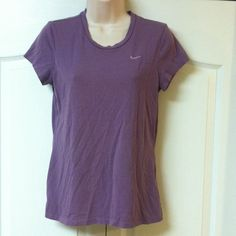 Nike sport tee Cute and cool Nike sports short sleeve tee. Dark lavender with lighter purple logo. 60% cotton 40% polyester. Pre loved in really good condition! I ❤️ OFFERS! TOP-RATED FAST SHIPPER USE BUNDLE FOR SAVINGS Nike Tops Tees - Short Sleeve